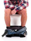 Man on toilet bowl — Stock Photo
