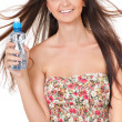 Girl with bottle of water — Stock Photo