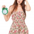 Girl with alarm clock — ストック写真