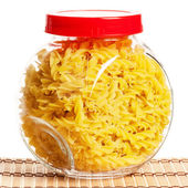 Pasta in glass pot — Stock Photo