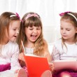 Girls reading book — Stock Photo