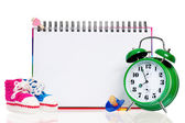 Blank card with baby shoes and alarm clock — Stock Photo