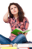 Girl holding book and thinking — Stock Photo