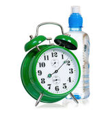 Clock with bottle of water — Stock Photo