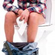 Man on toilet bowl — Stock Photo #43799575