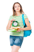 Girl with backpack and clock — Stock Photo