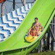 Father and son in aqua park — Stock Photo