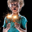 Crazy boy with sparklers — Stock Photo #47004205