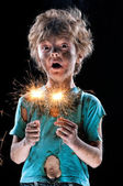 Crazy boy with sparklers — Stock Photo