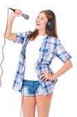 Girl with microphone — Stock Photo
