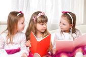 Girls reading book — Stock Photo