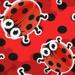 Red background with cute cartoon ladybug — Imagens vectoriais em stock