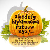 Happy Halloween cut out pumpkin small letters alphabet — Stock Vector