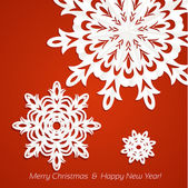 Applique snowflake Christmas card on juicy festive red background — Stock Vector
