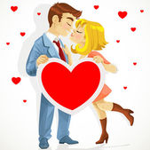 Beautiful young couple in love kissing and holding banner heart — Stock Vector