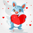 Cute little bunny holds a soft red heart-pillow Valentine gift - Stock Vector