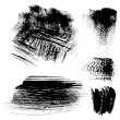 Black textured brush strokes on white background — Stockvectorbeeld