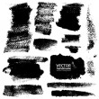 Strokes of black ink on textured paper - Stock Vector