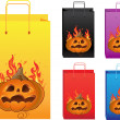 Halloween color shopping bags with fire and pumpkin — Stock Vector #33355487