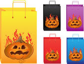 Halloween color shopping bags with fire and pumpkin — Cтоковый вектор