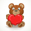 Teddy bear holding a heart isolated on white background — Stock Vector #38175275