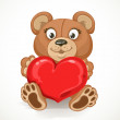 Beige teddy bear holding a heart isolated on white background — Stock Vector #38178465