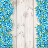 Spring forget-me-not on the wooden boards — Stock Vector