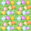 Multi-colored Easter eggs hidden in green grass — Stock Vector #42460863