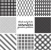 Set of black and white seamless geometric patterns — Stock Vector