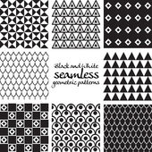 Set of black and white seamless geometric patterns — Stockvektor
