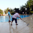 Alania, Turkey - August 31, 2008: Cleaner wash the floor near swimingpool  on August 31, 2008 in Alania, Turkey — Stock Photo