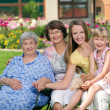 Four generations of women at countryside — Stock Photo