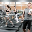Young man in fitness club — Stock Photo #13568592