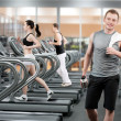 Stock Photo: Young man in fitness club