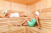 Two young woman relaxing in sauna — Stock Photo
