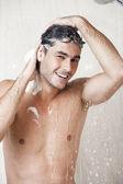 Yakışıklı bir adam duş — Stok fotoğraf