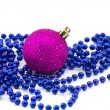 Christmas beads with bauble — Stock Photo