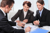 Agent with senior woman and her daughter — Stock Photo