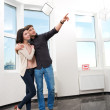 Couple in searching the real estate for a purchase — Stock Photo #23868225