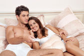 Happy couple watching television together — Stock Photo