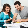 Stock Photo: Couple is considering future apartment design