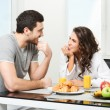 Beautiful couple having breakfast — Stock Photo