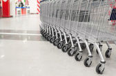 Row of empty cart in the supermarket — Stock Photo