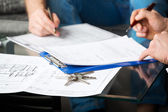 Two signing a document — Stock Photo