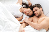 Young adult couple in bedroom — Stok fotoğraf