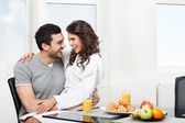 Beautiful couple having breakfast — Stock Photo