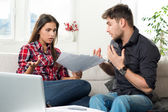 Quarreled couple with unpaid bills — Stock Photo