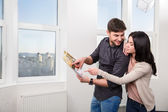 Couple in searching the real estate for a purchase — Stock Photo