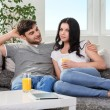 Couple sitting on a couch — Stock Photo