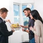 Couple is considering future apartment design — Stock Photo #30597435